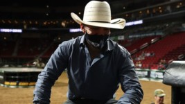 Alvidrez Will Not Let Broken Neck Stop him From Cheering on His Buddies at the World Finals in Arlington